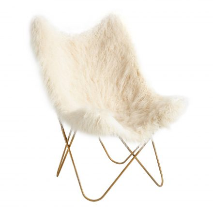 White fur butterfly shaped chair with gold legs