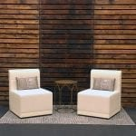 White leather chairs in front of pallet backdrop