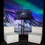 Northern Lights backdrop with white leather chairs in front
